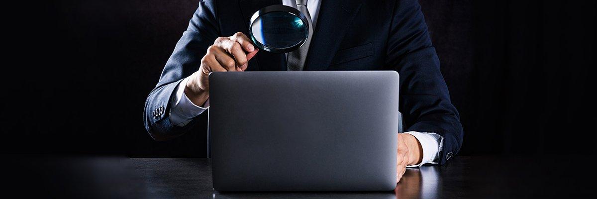 laptop-monitoring-magnifying-glass-adobe.jpg