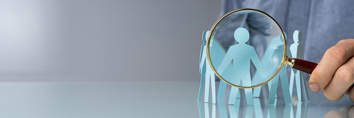 magnifying-glass-people-surveillance-zero-trust-adobe.jpg